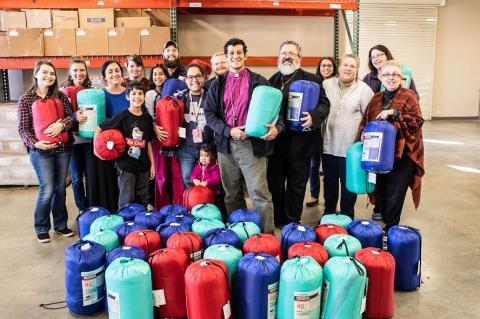 BEC gives sleeping bags to locals in need