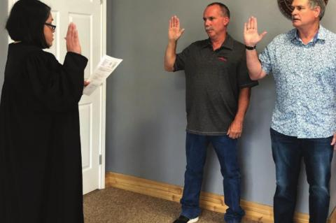 Two sworn in at May meeting