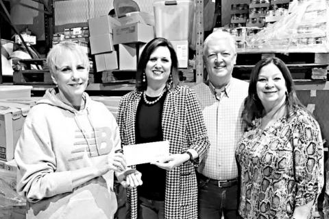From left, Melinda Bates, SLFM Office manager, presenting the award, Joy Long TVEC Public Relations Rep, and Michael and Brenda Williams, Pastors of International Outreach Church. Courtesy photo